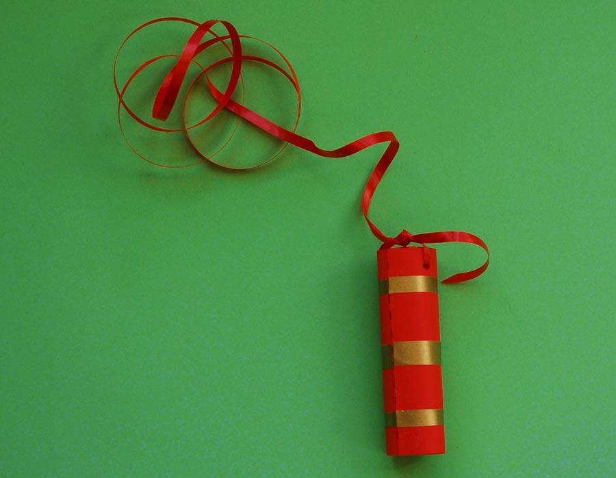 Tie the ribbon to the first firecracker