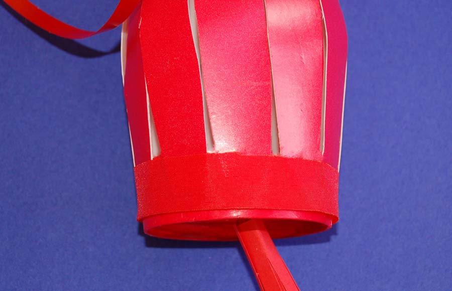 Stick ribbon around the bottom rim of the lantern