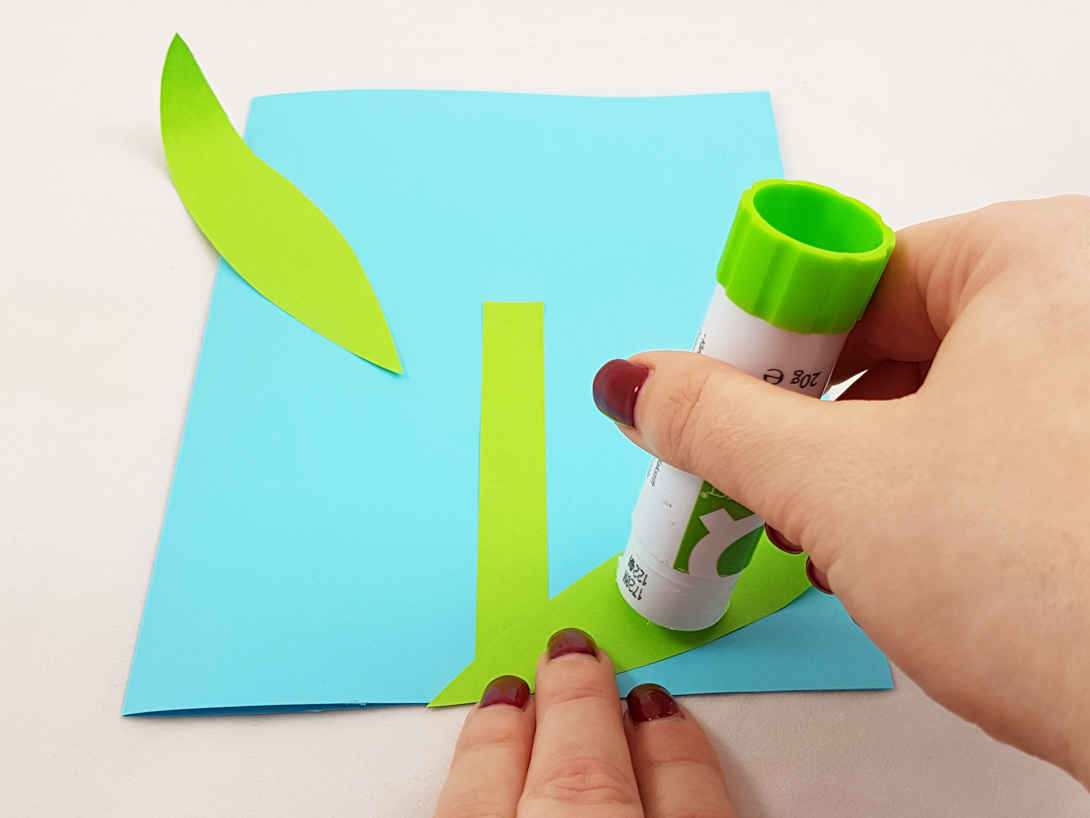 Glue the stem and leaves to your card