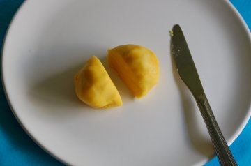 Cut the yellow marzipan in half