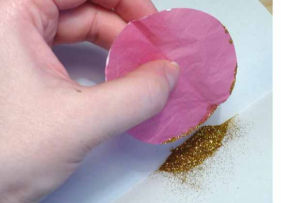 Roll the edge of your petals in glitter